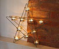 Black Metal Star-shaped Tea Light Holder by Parlane